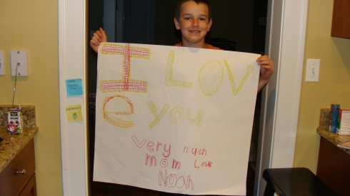 Noah, up at 6 to wish me a happy b. day.  This poster was truly a labor of love for this handwriting-spelling challenged sweet heart who loves to sleep in.  Dad is out of town and Noah wanted me to wake up with a birthday greating.  He's back in bed now!  God bless Him.