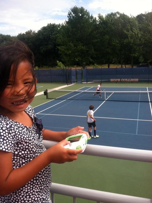 lainee recording Noah's tennis match.