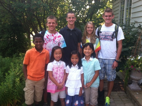 This was taken on the first day of school back in august.  This year we have an 11th grader and a 9th grader, one seventh grader, a sixth grader, one fourth grader, two third graders and our baby is in second grade.  Chris and I decided that all the Jones children would be in school this year.  For the first time in 16 years I don't have children here during the day.  the two older boys go to the christian high school and the younger 6 go to our christian grammar school.  :)  (i'm smiling)
